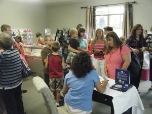Julie Cantrell signs at Cassie's Closet